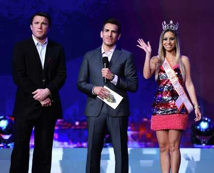 Co-host and mixed martial artist Chael Sonnen, co-host and former mixed martial artist Kenny Florian and Miss Hooters World 2012 Evelise Giorge de Souza of Brazil Photo: Ethan Miller, Getty Images / 2013 Getty Images