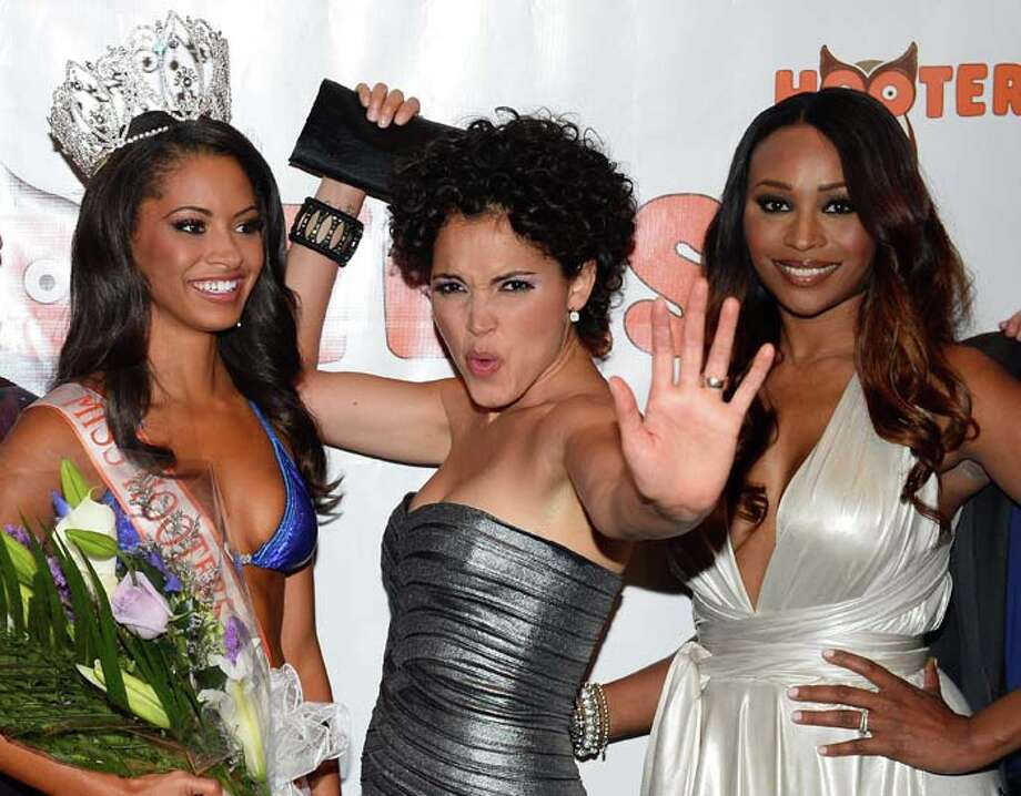Marissa Raisor of Newport, Kentucky, Miss USA 2003 and pageant judge Susie Castillo and model and pageant judge Cynthia Bailey Photo: Ethan Miller, Getty Images / 2013 Getty Images