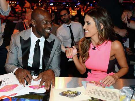 NFL free agent Terrell Owens (L) and television personality Audrina Patridge Photo: Ethan Miller, Getty Images / 2013 Getty Images