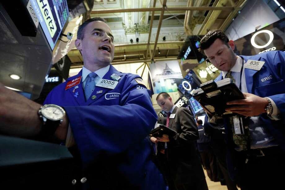 Specialist Jason Hardzewicz works at the New York Stock Exchange. Wall Street had a volatile month. Photo: Richard Drew, STF / AP