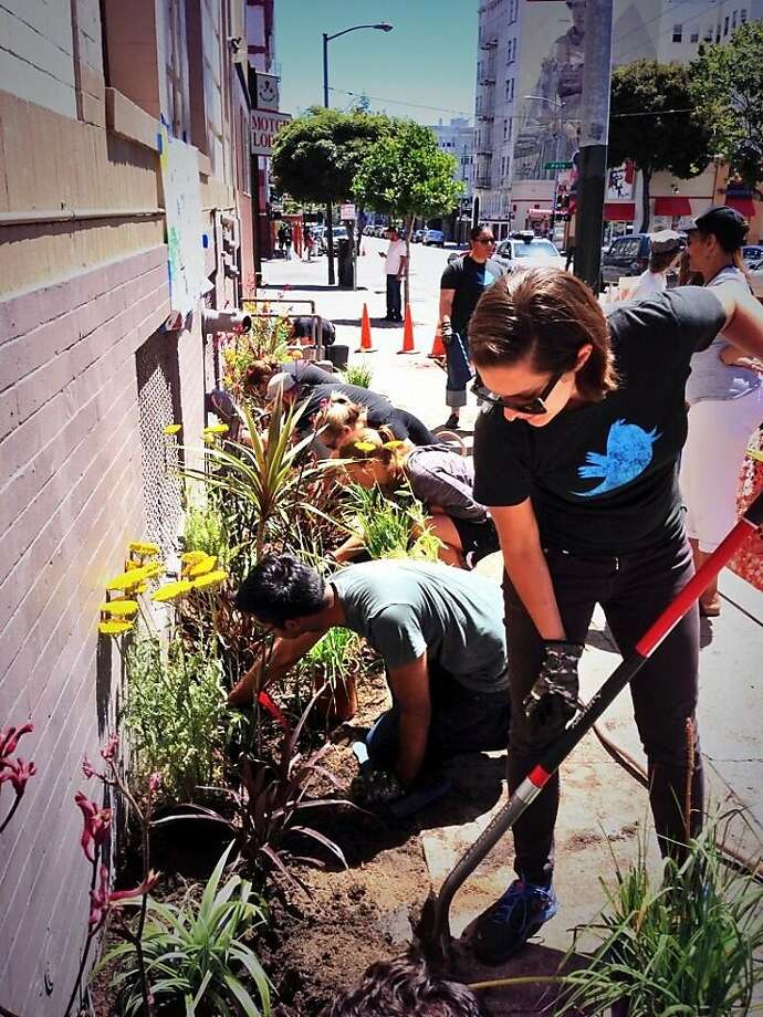 """Twitter employee Erica Anderson, left, works on a garden in the Tenderloin as part of the company's """"Friday for Good"""" volunteerism project. Photo: Karen Wickre, Twitter"""