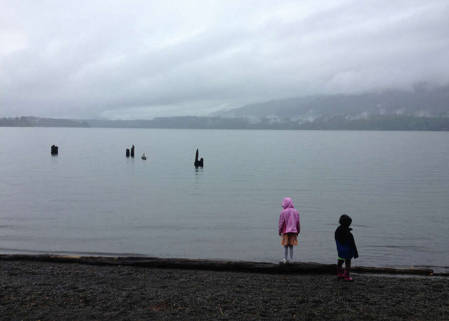 Kids check out the shores of Lake Quinault. The lake was recently closed by the Quinault Indian Nation to all use by non-tribal members. The tribes represented by the Quinault Indian Nation control access to the lake. Photo: JOSHUA TRUJILLO, SEATTLEPI.COM