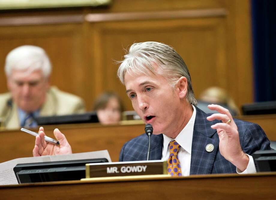 Rep. Trey Gowdy, R-SC, argues a point as the House Oversight Committee, led by Chairman Darrell Issa, R-Calif., meets in a politically contentious session to vote on whether to compel Internal Revenue Service official Lois Lerner to testify about the extra scrutiny the IRS gave to tea party and other conservative groups that applied for tax-exempt status, on Capitol Hill in Washington, in Washington, Friday, June 28, 2013. Lerner, the IRS supervisor who headed the tax-exempt division, appeared before the Republican-controlled panel with her attorney May 22 but cited her constitutional right to not answer questions and left after a dramatic standoff. The Oversight Committee contends Lerner forfeited her right to remain silent by making opening remarks at last month's hearing. (AP Photo/J. Scott Applewhite) Photo: J. Scott Applewhite, STF / AP