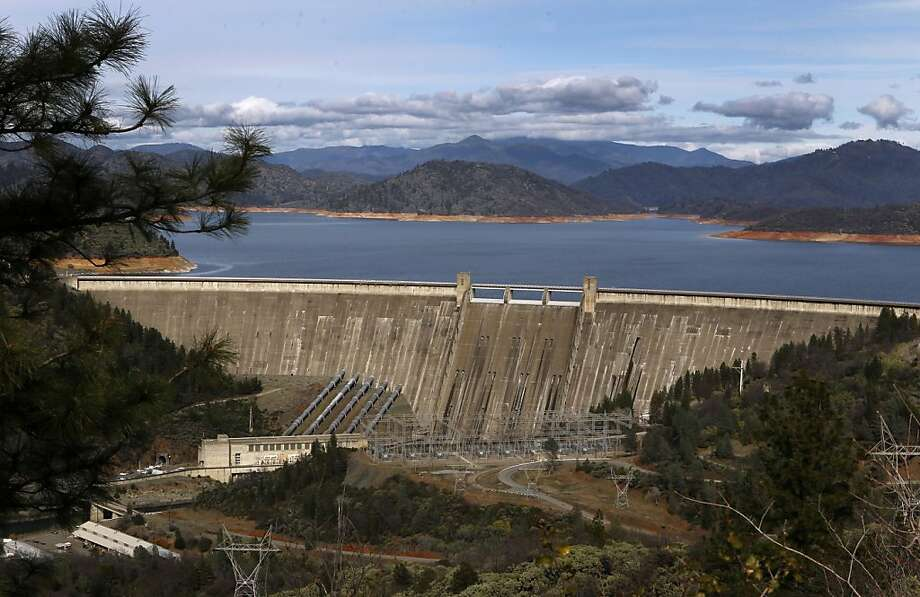 Shasta Dam holds back water in Shasta Lake early last year, when the lake level was just a bit higher than it is today. Photo: Paul Chinn, The Chronicle