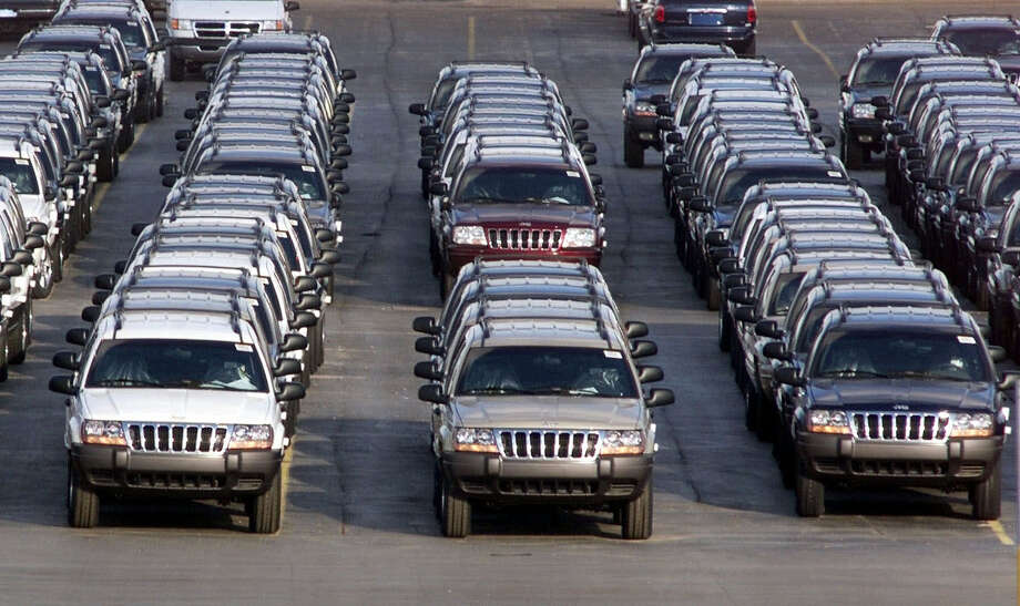 New Jeep Grand Cherokees are lined up outside the Jefferson North Assembly Plant in Detroit in 2001. An agreement between Chrysler and the U.S. government has removed about 1.2 million Grand Cherokees, model years 1999 to 2004, from a recall in June. Photo: Carlos Osorio, STF / AP