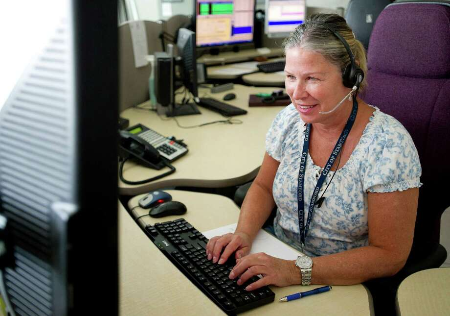 Sharon Ritchie answers 911 calls at Stamford Government Center on Friday, June 28, 2013. Photo: Lindsay Perry / Stamford Advocate