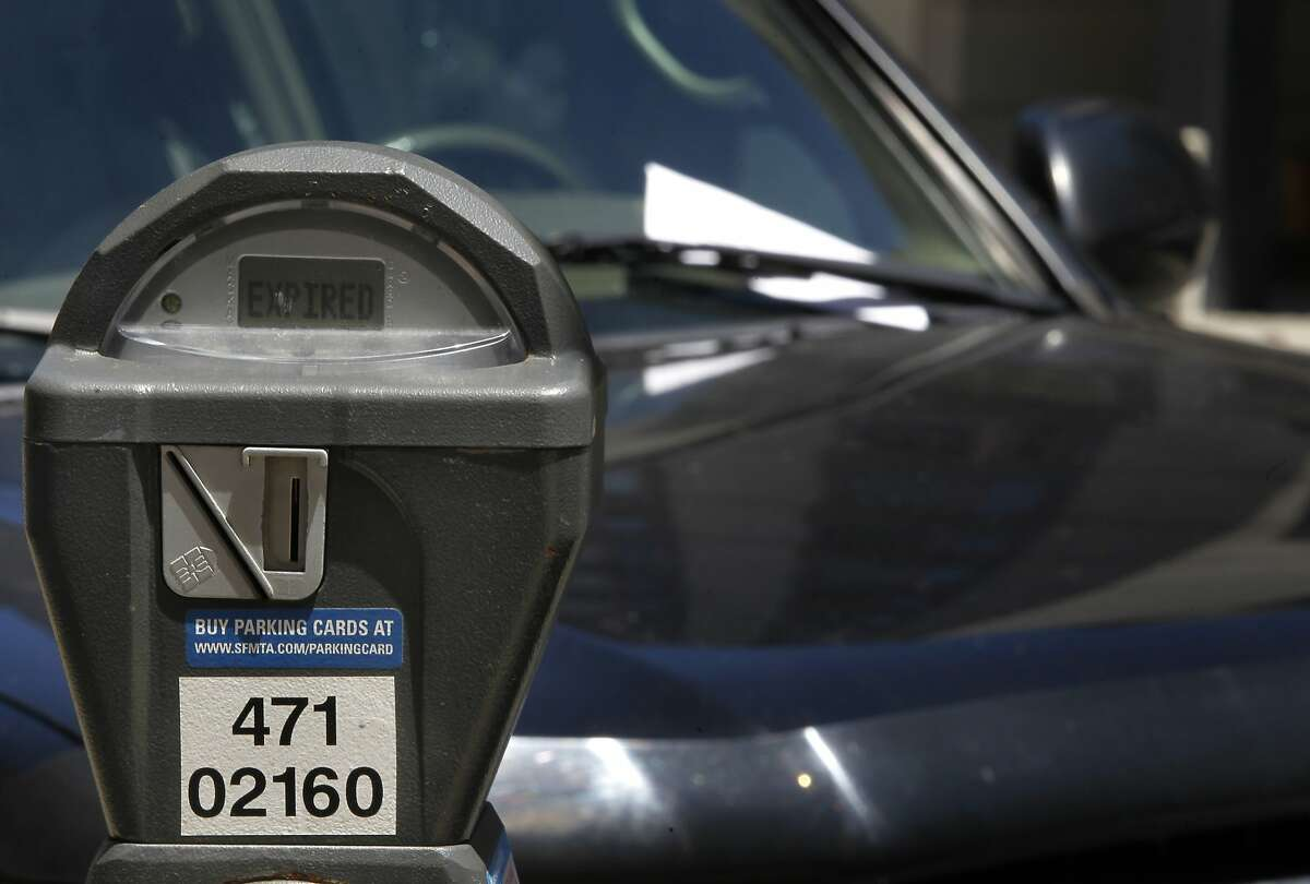 A parking ticket is left on a car parked at an expired meter on Harrison Street in San Francisco, Calif. on Friday, June 28, 2013. The violation for parking at expired meters jumps to $74 on July 1, making it the most expensive fine in the country.