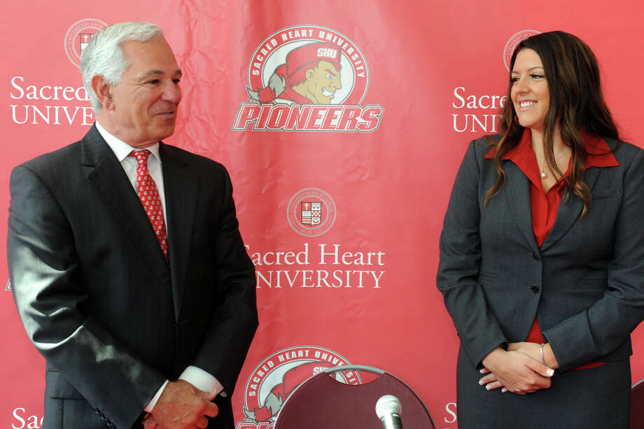 Bobby Valentine, Executive Director for Athletics at Sacred Heart University, introduces Jessica Mannetti as the new women's basketball coach during a press conference in the McMahon Center on campus in Fairfield, Conn., June 25th, 2013. Photo: Ned Gerard / Connecticut Post