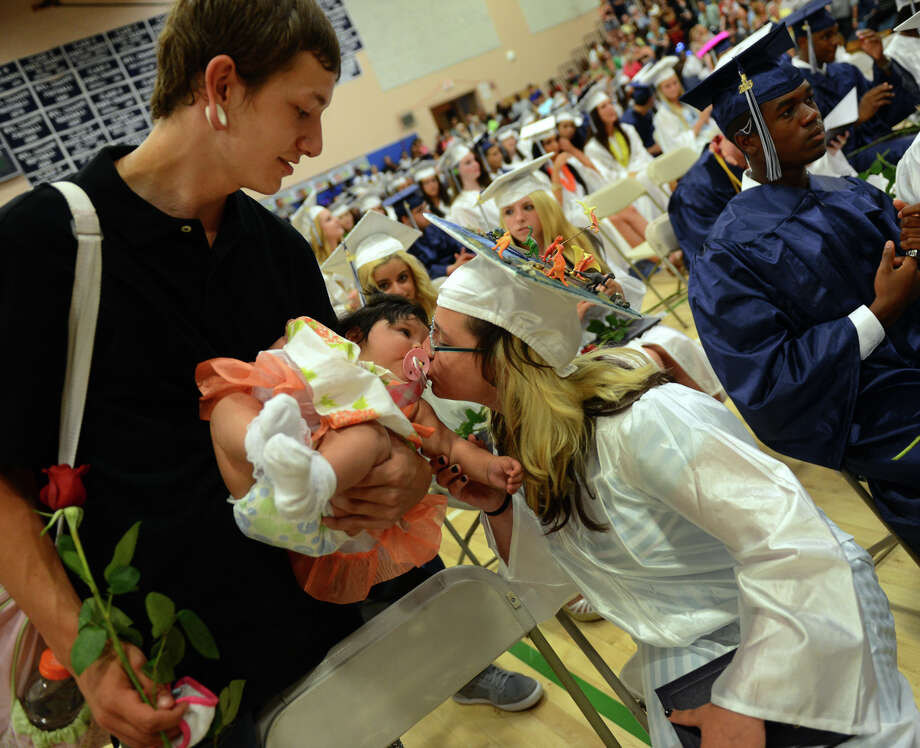 Graduate Danielle Dunican kisses her daughter Lillie-Auna as dad A.J. Gaites holds her, during Ansonia High School's Commencement Exercises in Ansonia, Conn. on Friday June 28, 2013. Photo: Christian Abraham / Connecticut Post