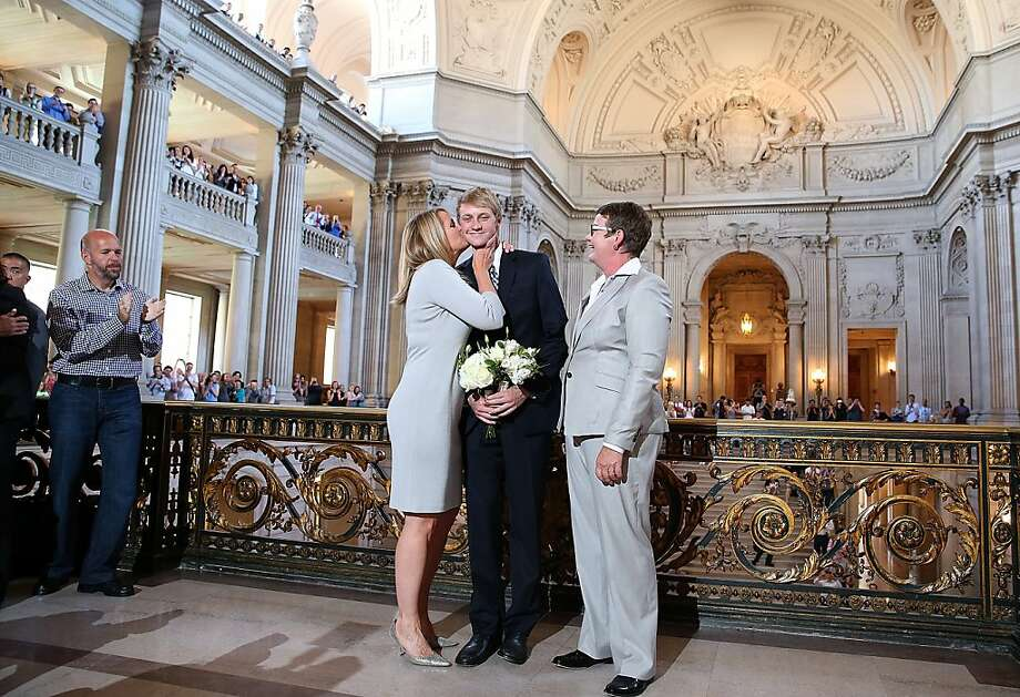 SAN FRANCISCO, CA - JUNE 28:  Same-sex couple Sandy Stier (L) and Kris Perry (R) kiss their son Elliot Perry (C) after they were married at San Francisco City Hall by California Attorney General Kamala Harris on June 28, 2013 in San Francisco, California.  The U.S. Ninth Circuit Court of Appeals lifted California's ban on same-sex marriages just three days after the Supreme Court ruled that supporters of the ban, Proposition 8, could not defend it before the high court. California Gov. Jerry Brown ordered all counties in the state to begin issuing licenses immediately. (Photo by Justin Sullivan/Getty Images) Photo: Justin Sullivan, Getty Images