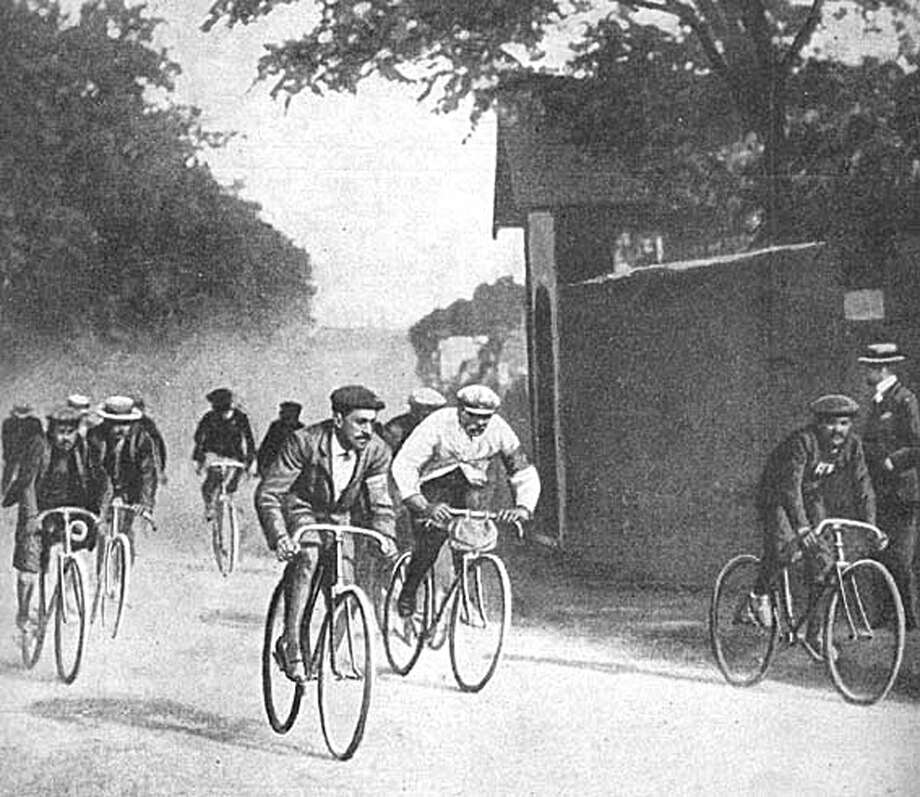 A newspaper reproduction of the inaugural Tour de France showing the winner Maurice Garin, center with pale jersey. While much has changed in the years since 1903, the race remains a grueling battle of brawn, brains and ambition. Photo: HO / CONSERVATOIRE DU PATRIMOINE SPOR