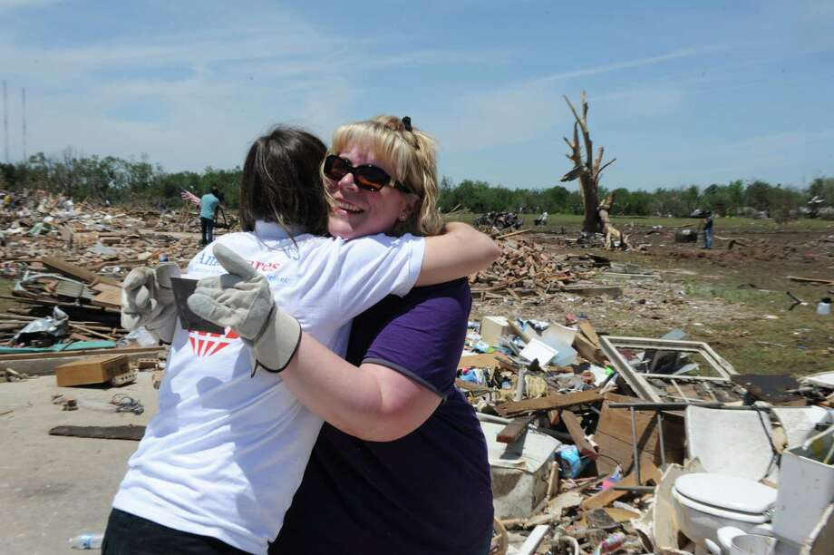 AmeriCares Emergency Response Manager Kate Dischino hugs a woman in Moore, Okla. as she inspects the damage from the May 20, 2013 tornado. Photo: Dru Nadler/AmeriCares