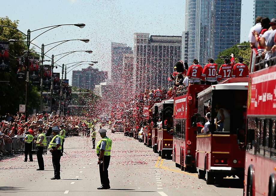 Chicago celebrates a second Cup win in four seasons as the Blackhawks roll by in buses. Photo: Jonathan Daniel, Getty Images