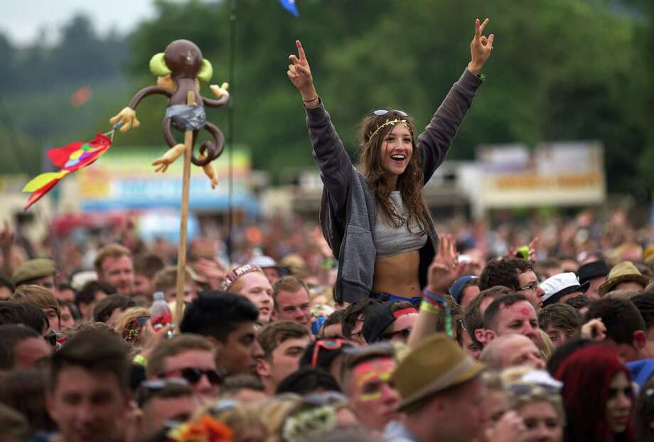 Festival goers attend concerts at the Pyramid Stage  during the third day of the Glastonbury Festival of Contemporary Performing Arts near Glastonbury, southwest England, on June 28, 2013. The festival attracts 170,000 party-goers to the dairy farm in Somerset, and this year's tickets sold out within two hours of going on sale. The Rolling Stones will perform at the festival for the first time, headlining on Saturday night. Photo: ANDREW COWIE, AFP/Getty Images / AFP ImageForum
