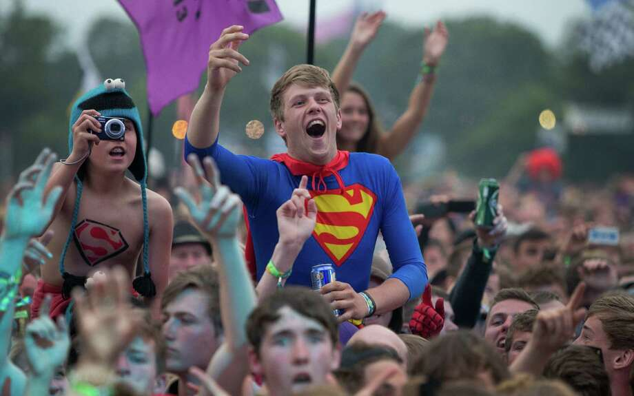 A man dressed as superman watches Dizzee Rascal perform on the Pyramid main stage at Glastonbury, England, Friday, June 28, 2013. Thousands of music fans have arrived for the festival to see headliners, Arctic Monkeys, Mumford and Sons and the Rolling Stones. Photo: Joel Ryan, Associated Press / Invision