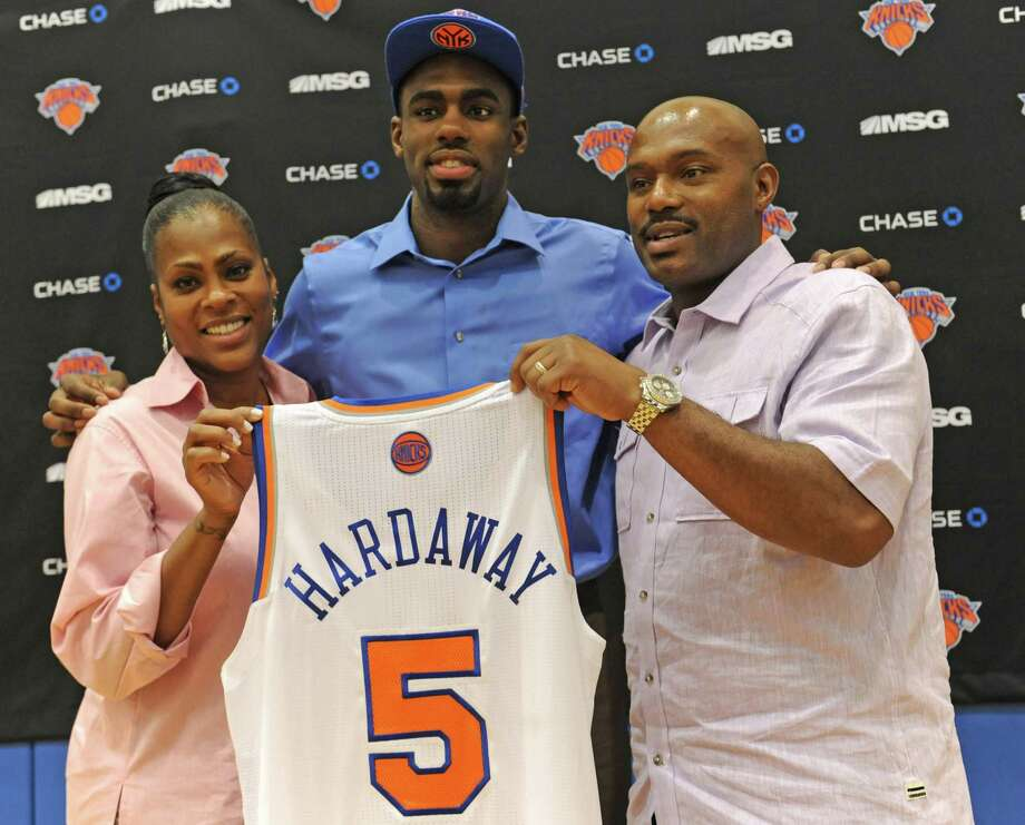 New York Knicks first round draft pick Tim Hardaway Jr., center,  poses for the media with his mother and father, Yolanda and Tim Hardaway Sr.,  at the Madison Square Garden training center in Greenburgh, N.Y.,  Friday, June 28, 2013. (AP Photo/ Louis Lanzano)   ORG XMIT: NYLL102 Photo: Louis Lanzano / FR77522 AP