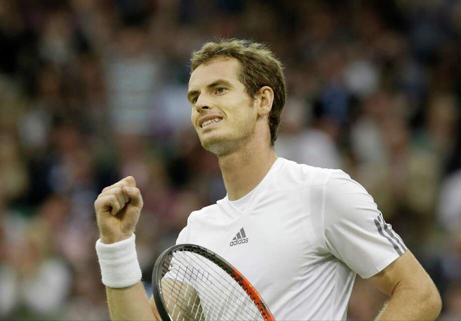 Andy Murray of Britain reacts after defeating Tommy Robredo of Spain during their Men's singles match at the All England Lawn Tennis Championships in Wimbledon, London, Friday, June 28, 2013. (AP Photo/Anja Niedringhaus)  ORG XMIT: WIM284 Photo: Anja Niedringhaus / AP