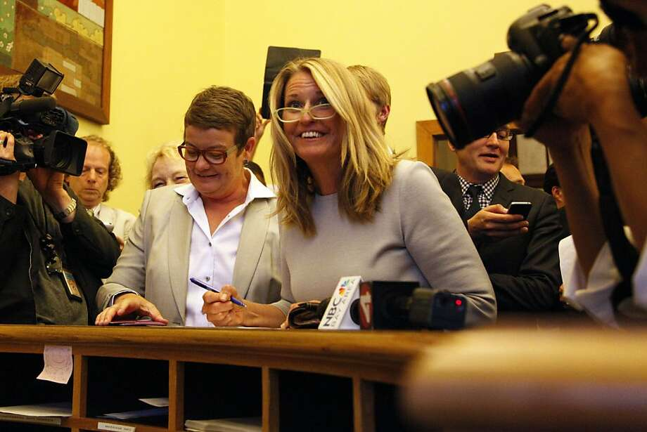 Lead plaintiffs in the Prop 8 case, Kris Perry, left, and Sandy Stierget their marriage license at the County Clerk's office in San Francisco, Calif., on Friday, June 28, 2013. Photo: Preston Gannaway, Special To The Chronicle