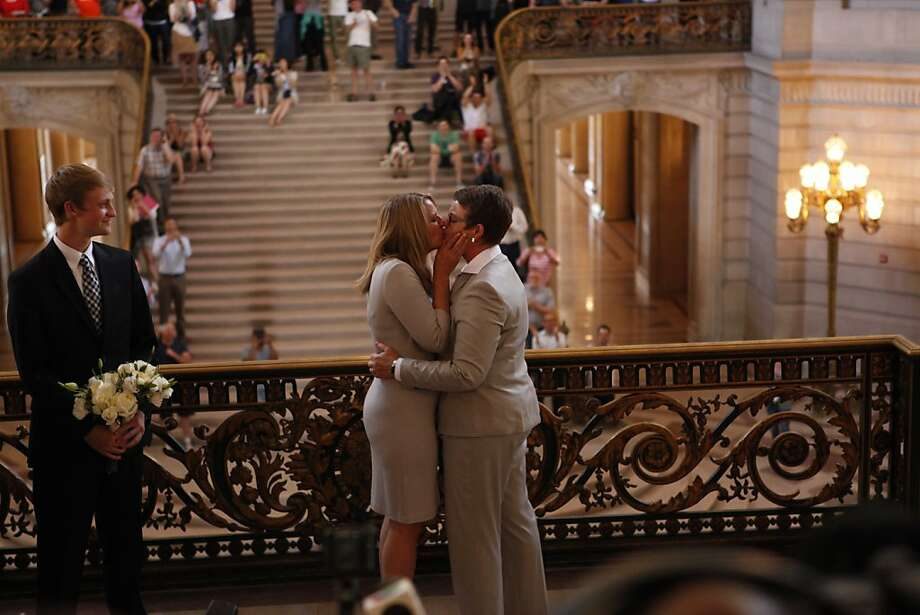 Sandra Stier and Kris Perry of Berkeley, one of the plaintiff couples, are the first couple to be married after the Ninth Circuit Court of Appeals lifted its stay on Friday, June 28, 2013 in San Francisco, Calif.  The couple was married by California Attorney General Kamala Harris outside of Mayor Ed Lee's office. At left is the couple's son, Elliot. Photo: Russell Yip, The Chronicle