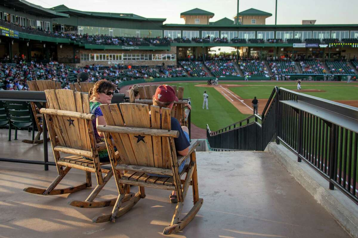 Fans relax in large wooden rocking chairs as they watch the Sugar Land Skeeters play the York Revolution at Constellation Field on Friday, June 28, 2013, in Sugar Land.