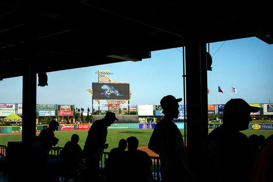 Fans arrive to watch the Sugar Land Skeeters play the York Revolution at Constellation Field on Friday, June 28, 2013, in Sugar Land. Photo: Smiley N. Pool, Houston Chronicle / © 2013  Smiley N. Pool