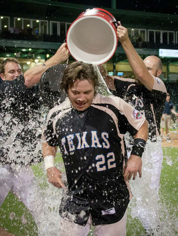 Sugar Land Skeeters catcher Koby Clemens is doused with water by his teammates after a victory over the York Revolution at Constellation Field on Friday, June 28, 2013, in Sugar Land. Clemens hit a three-run homer in the bottom of the ninth to give the Skeeters 12-11 walk-off win. Photo: Smiley N. Pool, Houston Chronicle / © 2013  Smiley N. Pool
