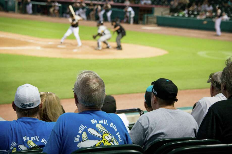 """Sugar Land Skeeters fans wear t-shirts bearing the team chant """"We will, We will, Bit You!"""" as they watch their team play the York Revolution at Constellation Field on Friday, June 28, 2013, in Sugar Land. Photo: Smiley N. Pool, Houston Chronicle / © 2013  Smiley N. Pool"""