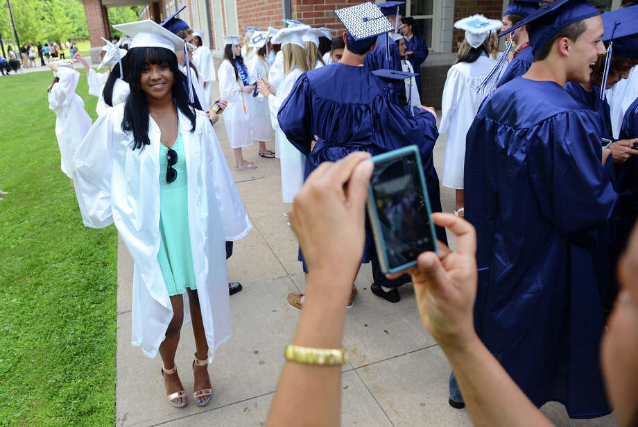 Proud mom Patricia Lee snaps a photo of her daughter and graduate Kristina before the start of Ansonia High School's Commencement Exercises in Ansonia, Conn. on Friday June 28, 2013. Photo: Christian Abraham / Connecticut Post