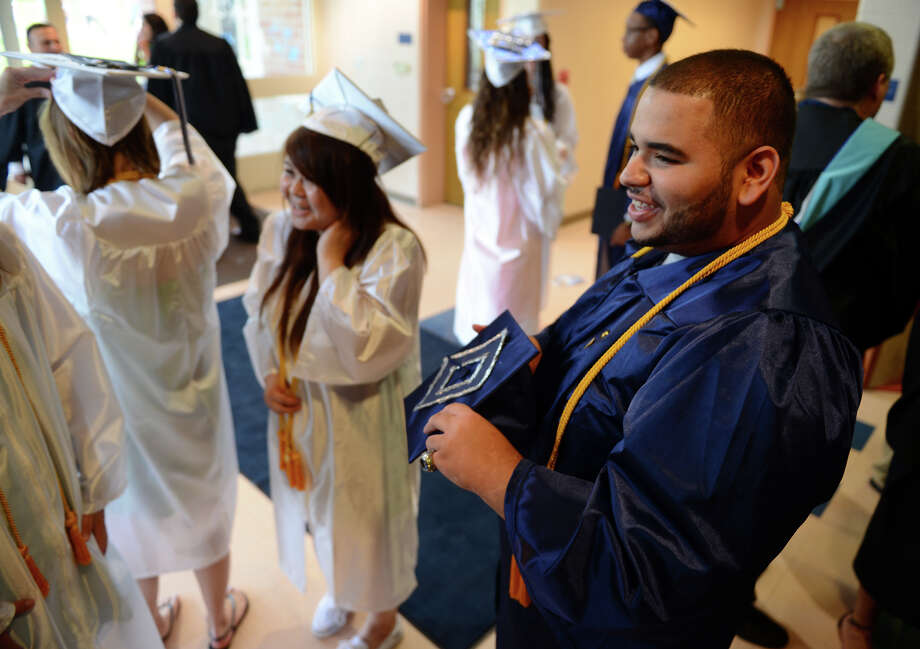 Graduate Kevin De La Cruz before the start of Ansonia High School's Commencement Exercises in Ansonia, Conn. on Friday June 28, 2013. Photo: Christian Abraham / Connecticut Post