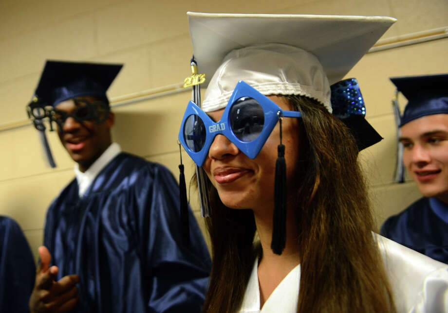 Graduate Jessica Johnson sports graduation sunglasses before the start of Ansonia High School's Commencement Exercises in Ansonia, Conn. on Friday June 28, 2013. Photo: Christian Abraham / Connecticut Post