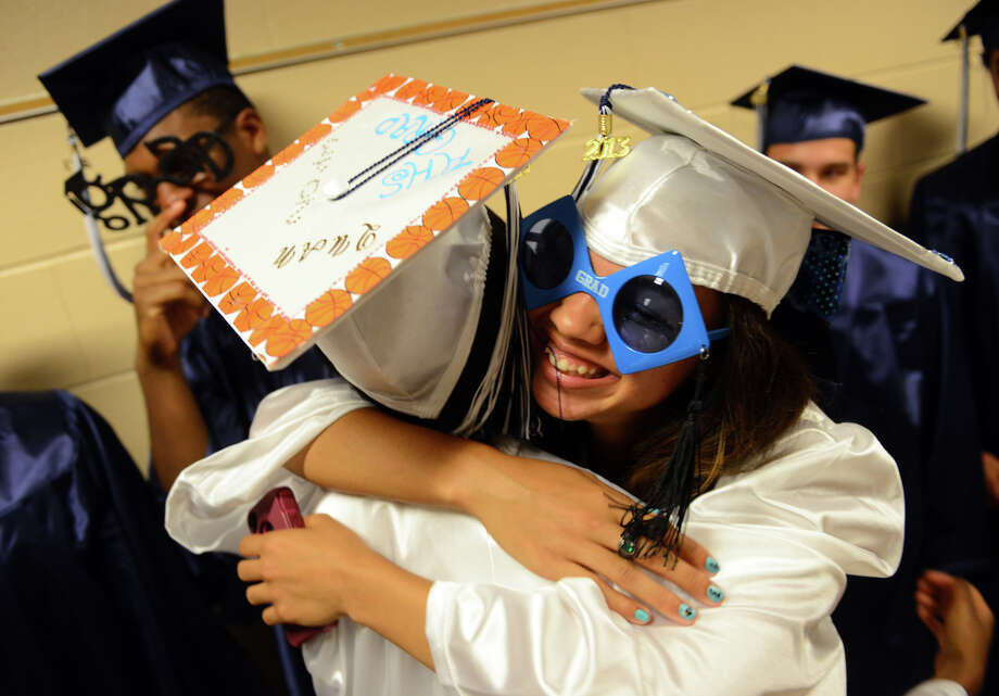 Graduate Jessica Johnson, right, hugs fellow classmate Quanisha Finney before the start of Ansonia High School's Commencement Exercises in Ansonia, Conn. on Friday June 28, 2013. Photo: Christian Abraham / Connecticut Post