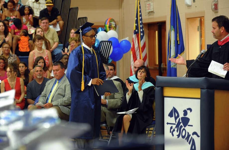 Ansonia High School Salutatorian Tobechukwu Law Umeugo speaks during the school's Commencement Exercises in Ansonia, Conn. on Friday June 28, 2013. Photo: Christian Abraham / Connecticut Post