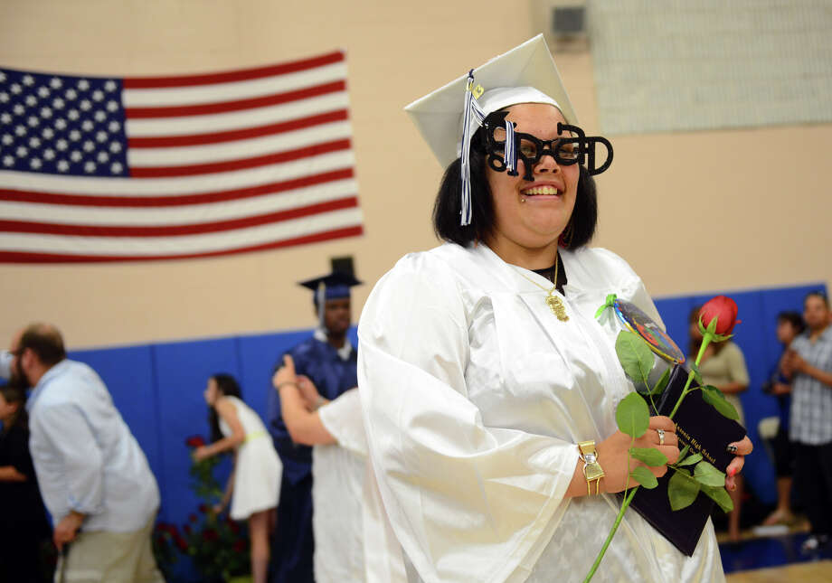 "Graduate Justyce Bradtaia-Lee DiOrio wears glasses that spell out ""Grad"" during Ansonia High School's Commencement Exercises in Ansonia, Conn. on Friday June 28, 2013. Photo: Christian Abraham / Connecticut Post"