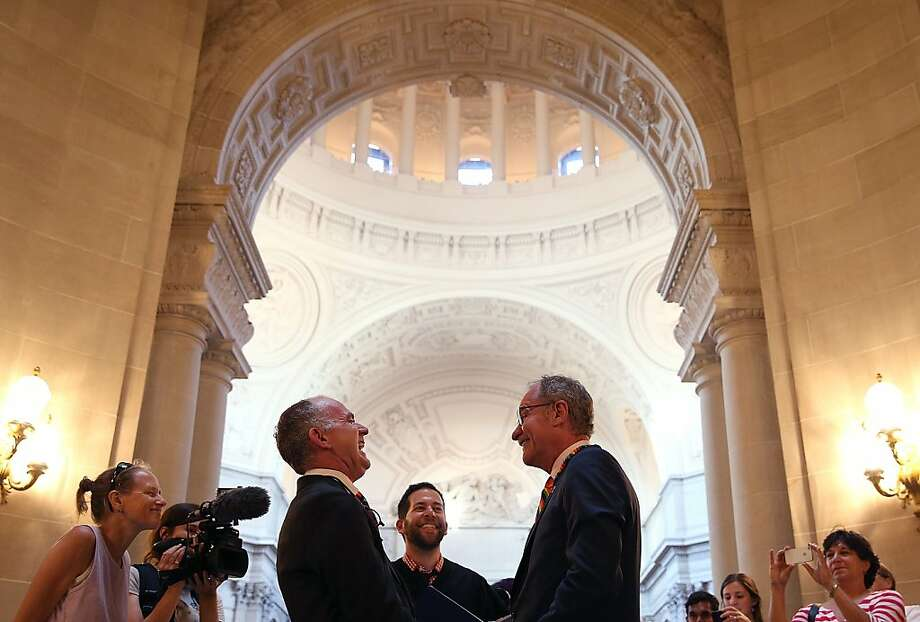 June 28, 2013: Same-sex couple Cosgrove Norstadt (left) and Jeff Foote (right) laugh while exchanging vows as they were married at San Francisco City Hall.  The U.S. Ninth Circuit Court of Appeals lifted California's ban on same-sex marriages just three days after the Supreme Court ruled that supporters of the ban, Proposition 8, could not defend it before the high court. California Gov. Jerry Brown ordered all counties in the state to begin issuing licenses immediately. Photo: Justin Sullivan, Getty Images