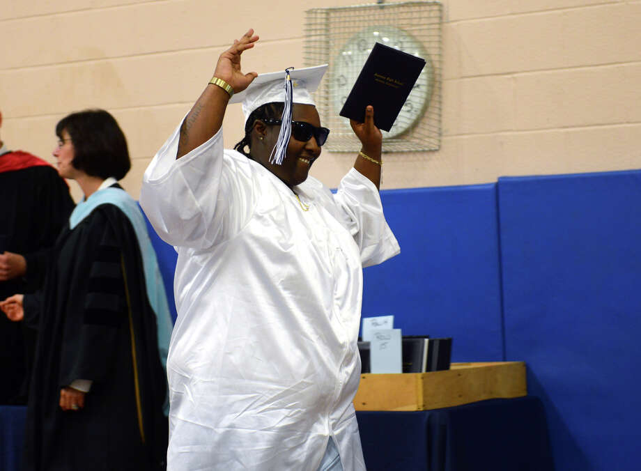 Graduate Kiara Nixon holds her diploma high in the air during Ansonia High School's Commencement Exercises in Ansonia, Conn. on Friday June 28, 2013. Photo: Christian Abraham / Connecticut Post