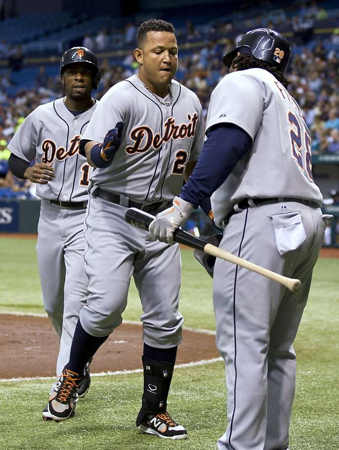 Detroit Tigers' Miguel Cabrera, center, and Austin Jackson, left, celebrates with on-deck batter Prince Fielder after Cabrera hit a first-inning, two-run home run off Tampa Bay Rays starting pitcher Alex Colome during a baseball game Friday, June 28, 2013, in St. Petersburg, Fla. (AP Photo/Chris O'Meara) Photo: Chris O'Meara, Associated Press