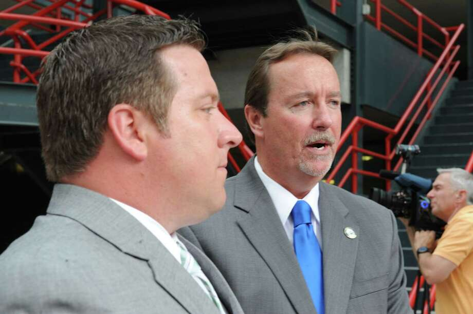 Albany County Executive Dan McCoy, left, and Bob Belber, general manager of the Times Union Center, address the issues of public safety surrounding manhole covers being blown out of place in the downtown section of Albany. The press  conference was held Friday, June 28, 2013, in front of the Times Union Center in Albany, N.Y. (Lori Van Buren / Times Union) Photo: Lori Van Buren / 00023006A