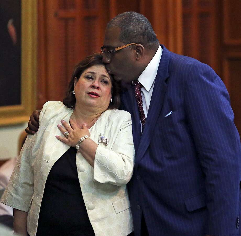Sen. Leticia Van de Putte is comforted Tuesday by Sen. Royce West, D-Dallas, after rushing back to the Senate. Photo: TOM REEL