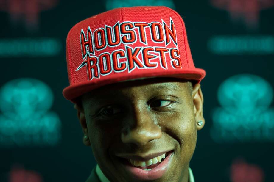 Isaiah Canaan, the 34th pick of the NBA draft, wears a Rockets cap as he is interviewed following a press conference.