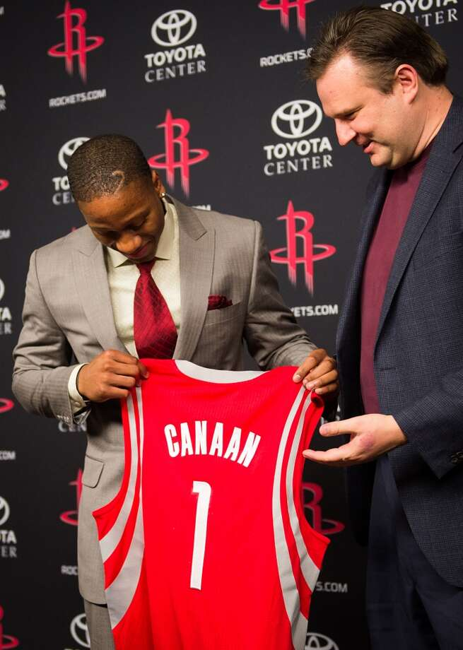 Isaiah Canaan, the 34th pick of the NBA draft, holds up a #1 Rockets jersey with general manager Daryl Morey.