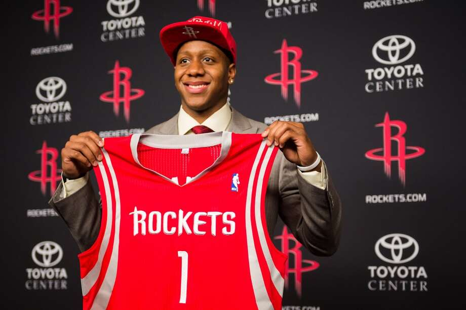 Isaiah Canaan, the 34th pick of the NBA draft, holds up a #1 Rockets jersey.