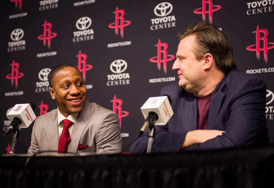 Isaiah Canaan, the 34th pick of the NBA draft, laughs with Rockets general manager Daryl Morey.