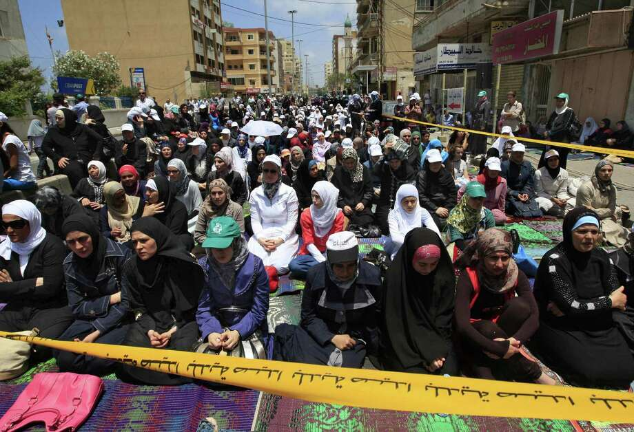 Supporters of hard-line Sunni cleric Ahmad al-Assir gather during Friday prayers in Sidon, Lebanon. Al-Assir has been on the run since the military crushed his fighters this week. Photo: Mohammed Zaatari / Associated Press