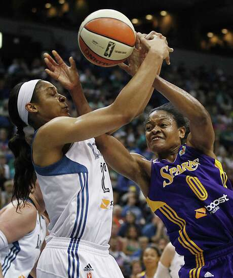 Maya Moore (left) and the Lynx defeated Alana Beard and the Sparks on Friday in Minneapolis. Photo: Stacy Bengs / Associated Press