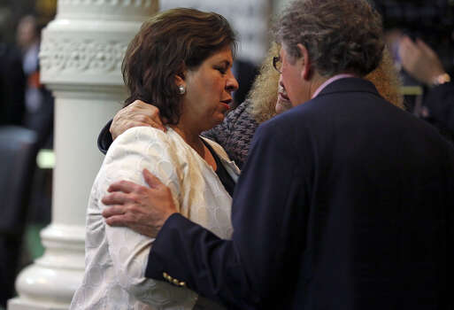 Senator Leticia Van de Putte is comforted by colleagues as she makes the Senate floor on Tuesday night as Fort Worth Senator Wendy Davis filibusters in an effort to cause abortion legislation to die without a vote on the floor of the Senate Tuesday, June 25, 2013. Photo: For The San Antonio Express-News