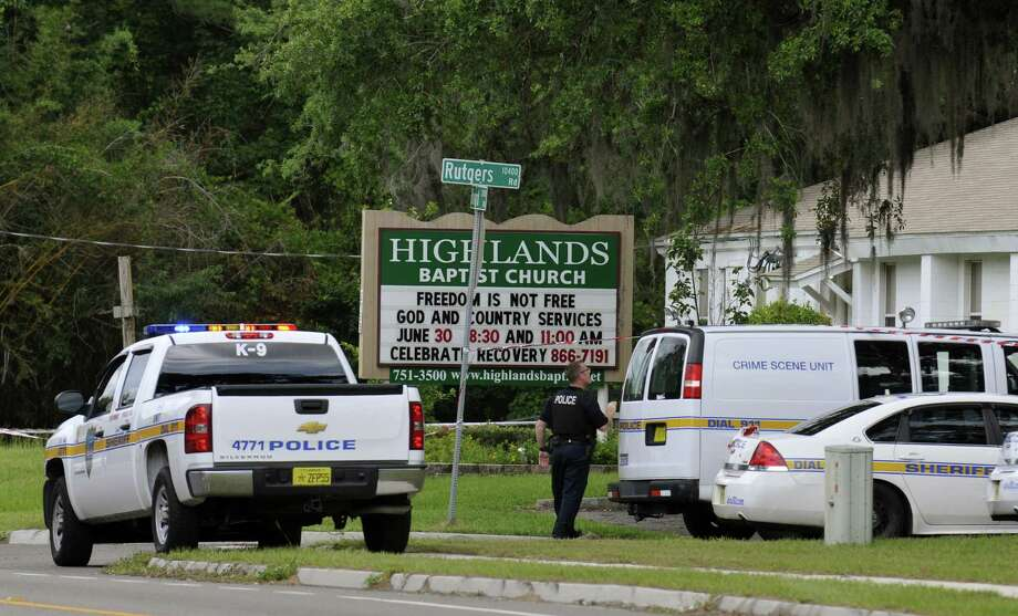 Police gather June 22 at the Highlands Baptist Church in Jacksonville, Fla., where authorities said the body of 8-year-old Cherish Perrywinkle was found. Photo: Will Dickey / Associated Press