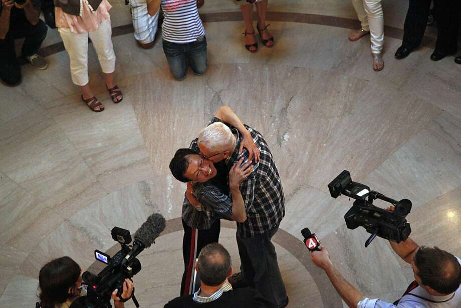 Gordon Yim (left) and Martin Vatis embrace after their same-sex marriage ceremony at City Hall in San Francisco, Calif., on Friday, June 28, 2013. Photo: Preston Gannaway, Special To The Chronicle