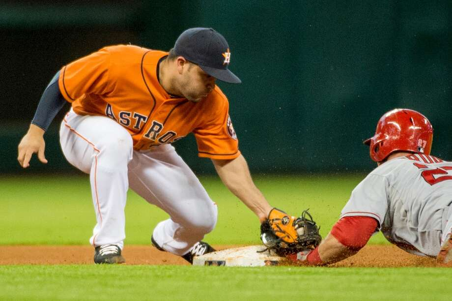 Angels center fielder Mike Trout is safe at second with a stolen base as Astros second baseman Jose Altuve applies the tag late.