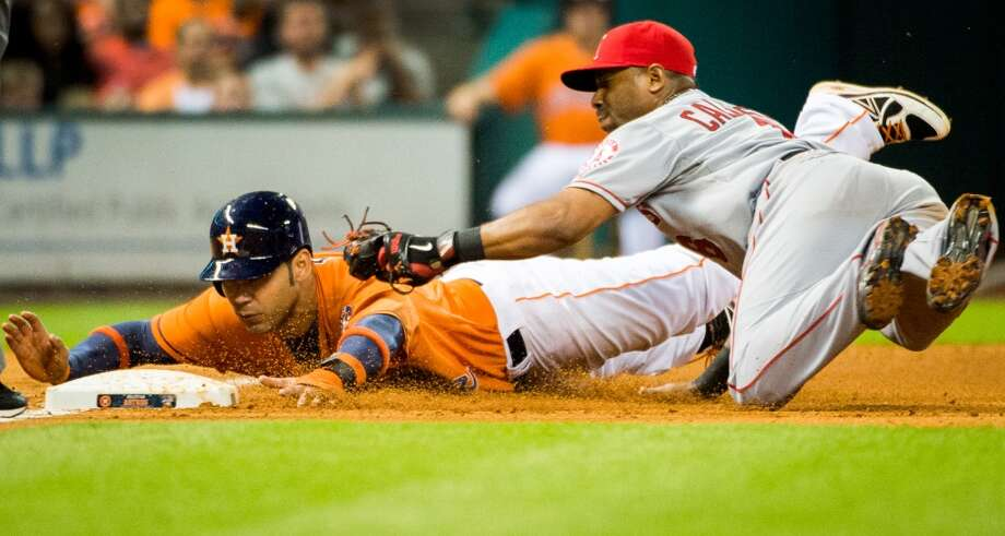 Astros designated hitter Carlos Pena is out at third base as Angels third baseman Alberto Callaspo applies the tag.