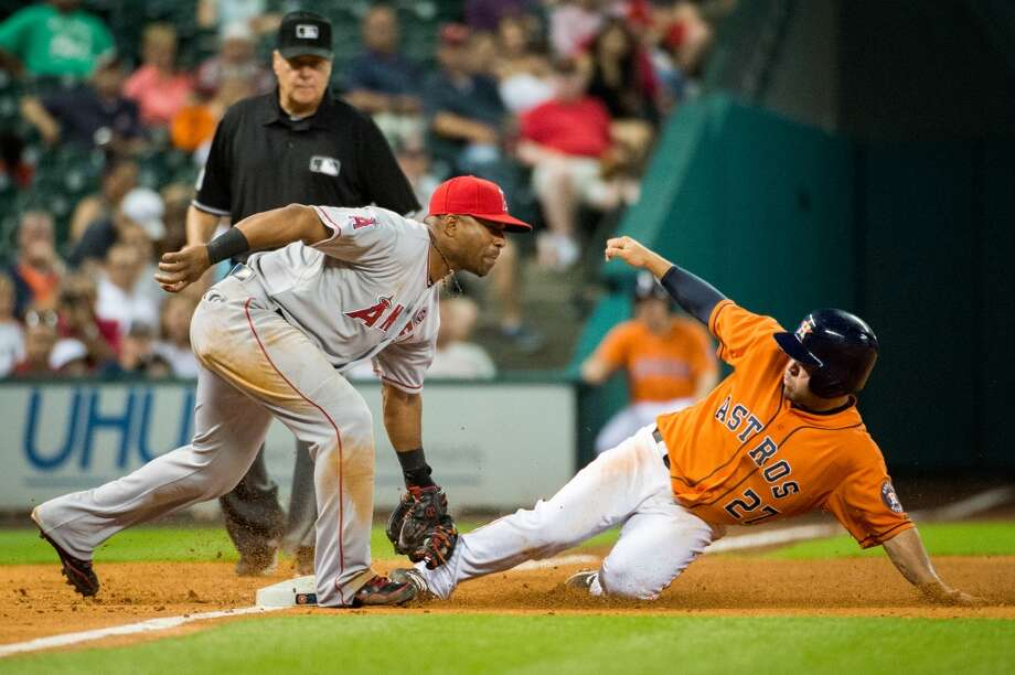 Angels third baseman Alberto Callaspo applies the tag as Astros second baseman Jose Altuve is caught stealing.